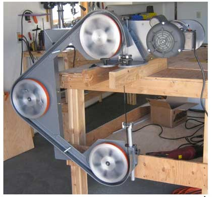 three-wheeled portable bandsaw drive train is so smooth there is virtually no blade flap